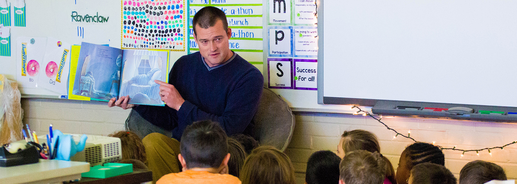 Kenneth Upham Reading to Students