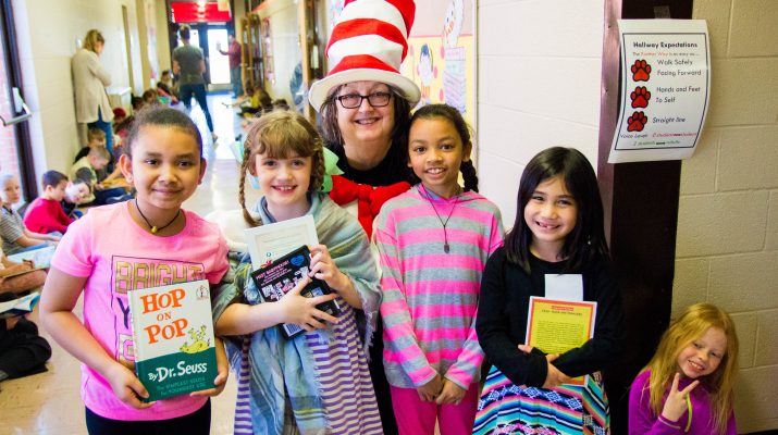 Librarian in Hallway with Students Dressed as Cat in the Hat