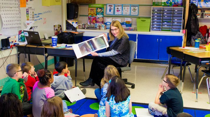 Melanie Laster Reading to Students