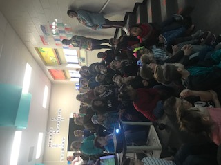 3rd, 4th, & 5th graders listening to author